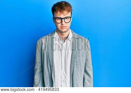 Young caucasian man wearing elegant clothes and glasses depressed and worry for distress, crying angry and afraid. sad expression.