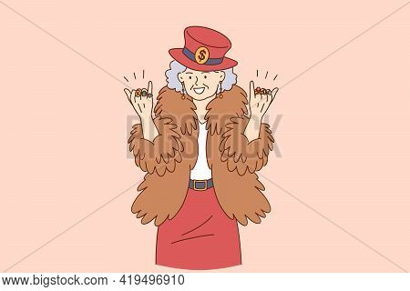Stylish Funny Elderly People Concept. Happy Grandmother In Hipster Coat Hat With Rings On Fingers Ca