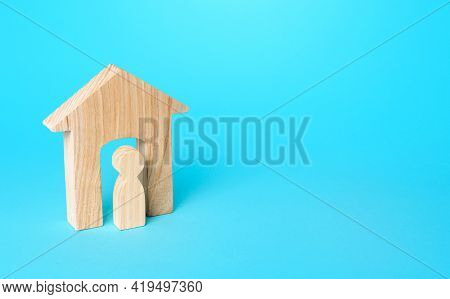 A Figurine Of A Man In A Wooden House. Affordable Housing, Realtor Services. Rent Of Real Estate. Mo