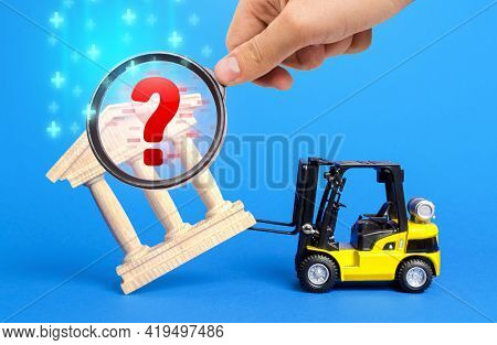 Forklift Truck Removes Bank Building And Magnifying Glass. Audit And Accounting Violations. Liquidat