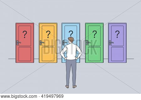 Hard Decision, Success Or Failure Concept. Businessman Standing Backwards In Front Of Colourful Door
