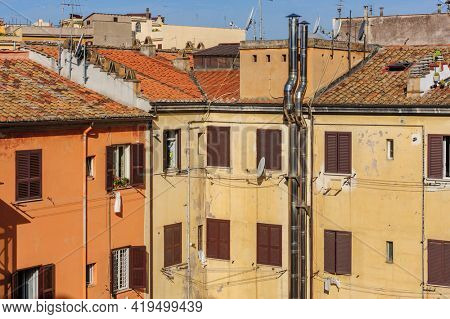 Rome, Italy, August 2014: Typical natural view of usual old residential buildings with tile rooftops in Rome, Italy