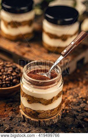 Classic Tiramisu Dessert With Cocoa Powder In Top Served In Jar