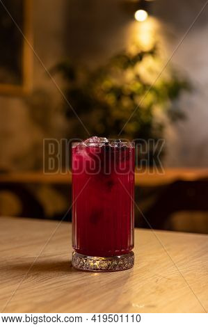 Cold Refreshing Drink With Blueberries And Ice On A Restaurant Table