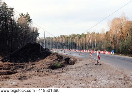 Road Section Closed For Repair Work With Warning Signs-the Concept Of Spring Road Repairs