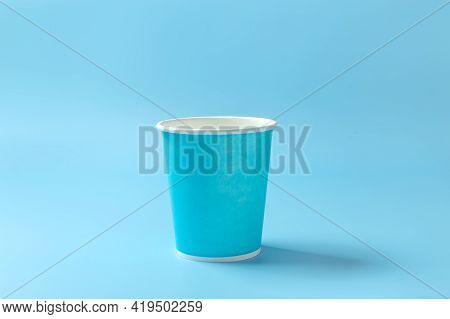 Disposable Paper Cup On A Light Blue Background. Disposable Tableware. Concept. High Quality Photo