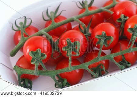 Organic Cherry Tomatoes In A Paper Box. Close Up.