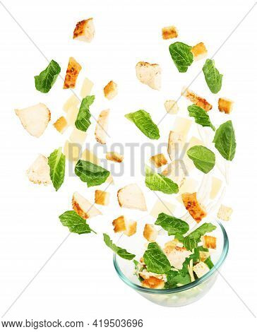Glass Salad Bowl In Flight With Vegetables Isolated On White Background