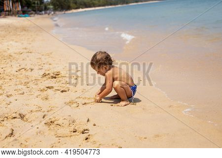 Adorable Toddler Toddler Has Fun Playing On Sandy Beach Of Tropical Sea
