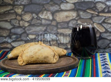 Northern Empanadas, Meat Fries And A Glass Of Red Wine. Argentine Gastronomy