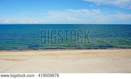 Sea. Ocean. Sea Surface. Almost Calm. Deserted Beach. Horizon Line. Dark Blue Water, Clean Sandy Bea