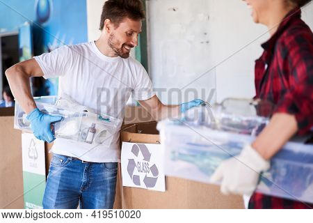 Man Sorting Rubbish At The Garbage Sorting Factory