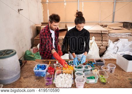 People Sorting Materials In The Waste Sorting Plant