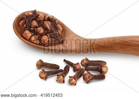 Dry Cloves In Wooden Spoon Isolated On White Background With Clipping Path And Full Depth Of Field.