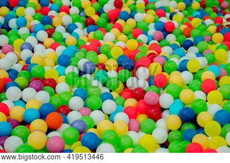 Many Colourful Plastic Small Balls In A Kids' Ball Pit At Indoor Playground. Sinkhole. Pit. Hole. Fu