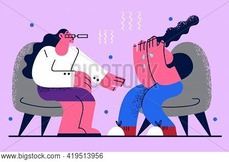 Psychotherapist Help And Assistance Concept. Young Crying Woman Sitting In Armchair Telling Her Feel