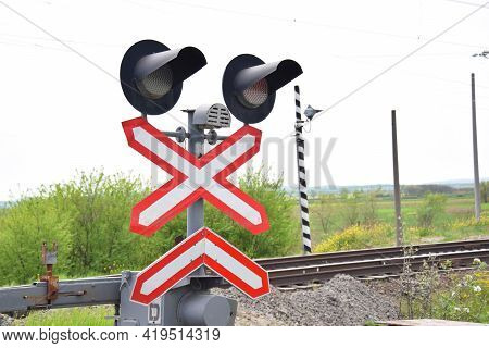 Railway Level Crossing With Semaphore And Barrier. Warning Road Sign On The Proximity Of A Railway C