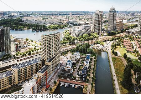 Majestic Drone View Of Contemporary City With Residential Buildings And River On Sunny Day In Summer