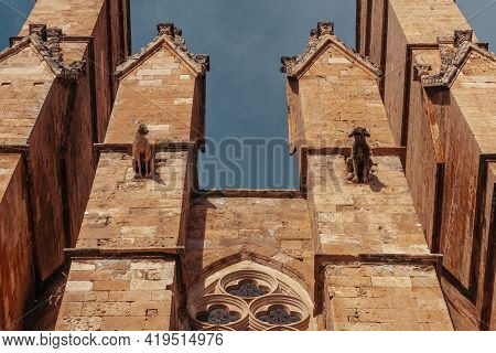 Gargoyles On The Facade Of Gothic Roman Catholic Cathedral Of Santa Maria Of Palma Cathedral Of St.