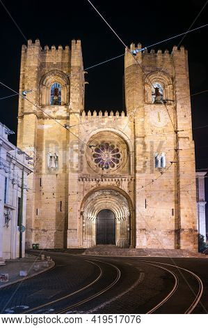 Lisbon Cathedral Illuminated At Night In The Alfama District, Portugal