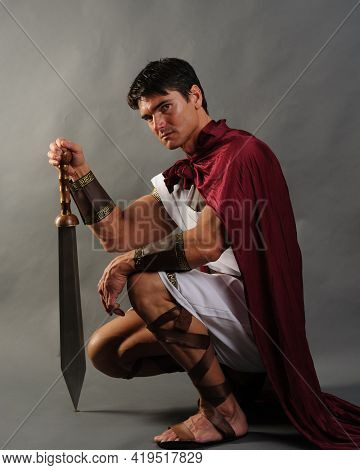The Sexy Medieval Soldier Poses For The Photo.