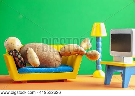 A Quirky Metaphorical Concept Image Showing A Potato Man Lying On A Couch Watching Tv In A Living Ro