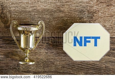 Turning An Artwork Into Non Fungible Token (nft) Concept With A Trophy On One Side And A Symbolic Nf