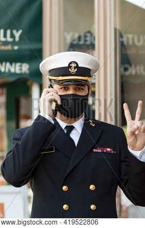 Annapolis, Md, Usa 05-02-2021: A Cadet Attending To Us Naval Academy Is Wearing A Face Mask Due To C