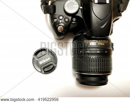 Moscow, Russia, May 2021, Nikon Camera With Lens On White Background.