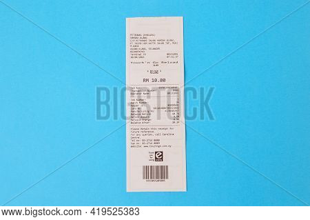 Klang,malaysia: May 6, 2021-paper Sales Receipt Isolated On A Blue Background