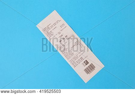 Klang, Malaysia: May 6, 2021- Paper Sales Receipt Isolated On A Blue Background