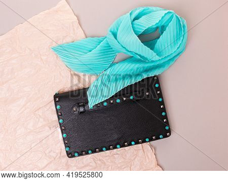 Black Women's Clutch Made Of Genuine Grained Leather, Decorated With Metal Rivets And Rivets With Tu
