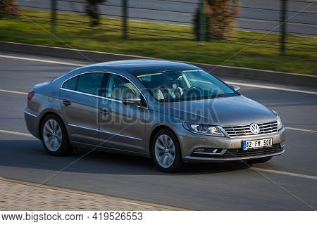 Alanya, Turkey  - April 17  2021:    Silver Volkswagen Passat  Is Driving Fast On The Street On A Wa
