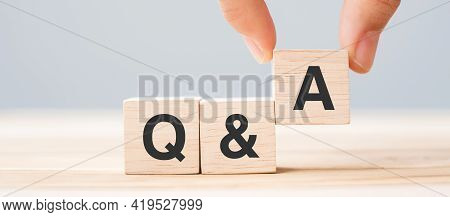 Hand Holding Q And A Word With Wooden Cube Block. Faq( Frequency Asked Questions), Answer, Question