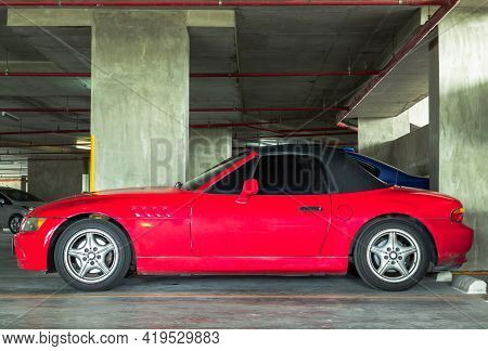 Bangkok, Thailand - 02 May 2021 :  The Side Of Red Sports Car Parked In The Parking Lot. The Side Of