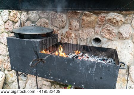 Large Cauldron With Freshly Cooked Rice. A Series Of The Process Of Cooking Pilaf In A Huge Cauldron