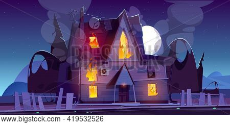 Fire In House At Night, Burning Suburban Cottage With Flame In Windows. Long Blaze Tongues Raging Ov