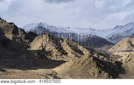 Beautiful Landscape Of Mountains With Sun Over Them In Ladakh. Captured During Snowfall.