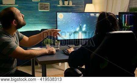 Couple Of Gamers Losing Space Shooter Tournament