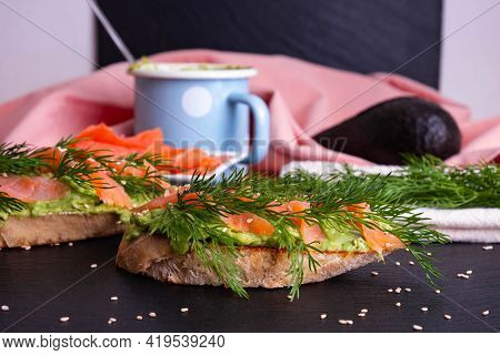 Making Delicious Crispy Canapes With Avocado And Smoked Salmon Fillet And Fresh Dill Sprigs And Spri