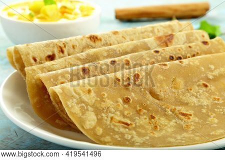 Homemade Fresh Whole Wheat Chapati Served With Curry,