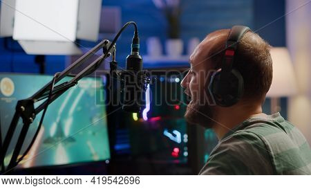 Streamer Man Talking Into Microphone With Other Players During Space Shooter
