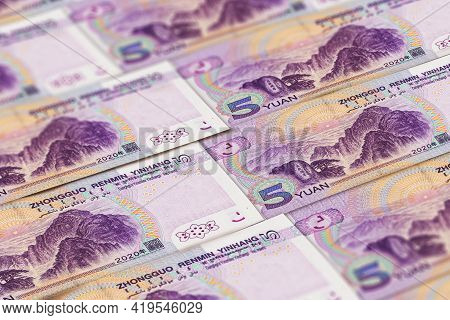 5 Chinese Renminbi Banknotes Background. China Money, Beijing.