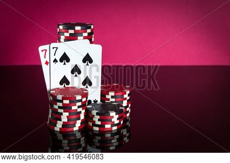 Poker Cards With One Pair Combination. Close-up Of Playing Cards And Chips In Poker Club. Free Adver