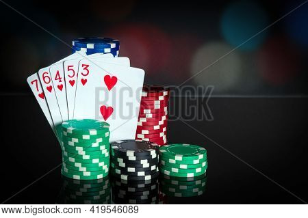 Poker Cards With Straight Flush Combination. Close-up Of Playing Cards And Chips In Poker Club. Free