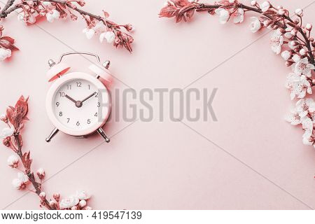 Summer Time. Spring Blossom And April Floral Nature With Alarm Clock On Pink Background. Beautiful S