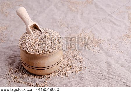 Dry White Chia Seeds In A Wooden Bowl On A Textile Background. Selective Focus.