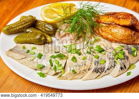 Pickled Herring With Pickles And Herbs. Close-up, Selective Focus