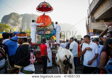 KUALA LUMPUR - JANUARY 27: Hindu devotees carry 'kavadi' as offering to Lord Muruga with beliefs to avert great calamity, on January 27, 2013 during the Thaipusam festival in Kuala Lumpur, Malaysia.