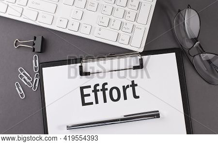 Office Paper Sheet With Text Effort And Keyboard. Business